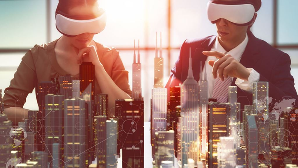 Two people blindfolded sitting in front of a model of a city skyline