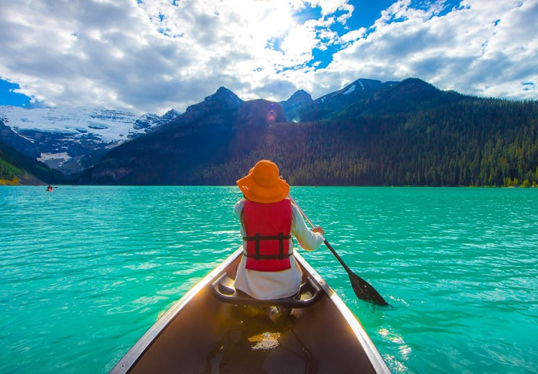 Woman canoeing on Lak Louise, Canada.